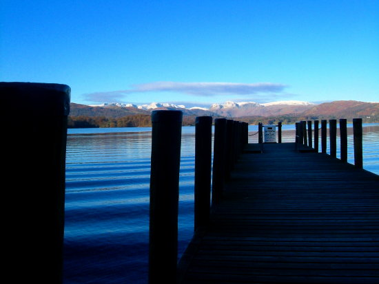 lake pier jetty water view mountains lake district