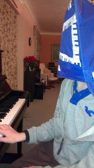 One of my pupils was embarassed at how little practice he had done, so he put his music bag on hi...