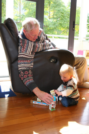 Nico and Grandad building with some birthday blocks.