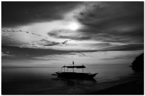 lonely boat sea beach water philippines bw