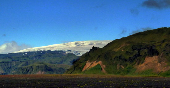 Glacier,geen hills and black sand in Iceland
