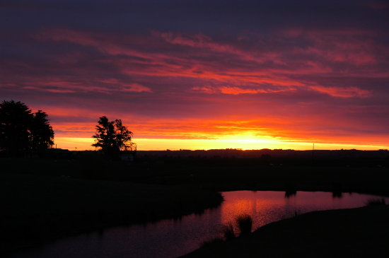 Southern Hemishere Sunset it's springtime in September at Waiata, North Island, New Zealand