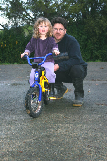 Test drive of Lauren's birthday present.  (Trainer wheels yet to be attached).