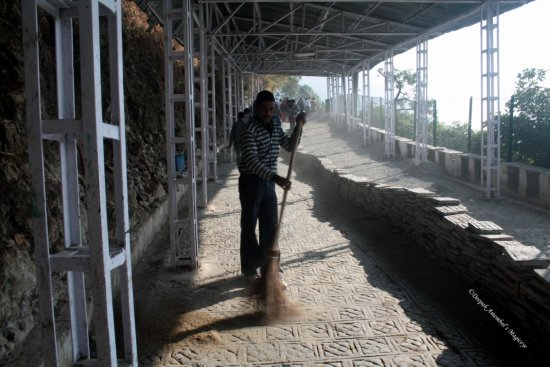 Sweeping away horse dung on path to Vaishnodevi