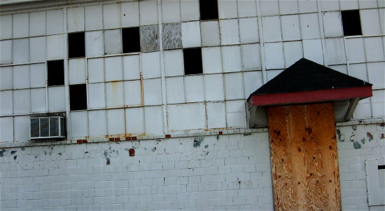 boarded door white wall window grid