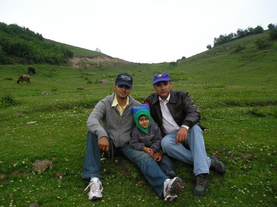 Summer Vacation.. Sirri.. My Friend, his Son and I relaxing along the lake.