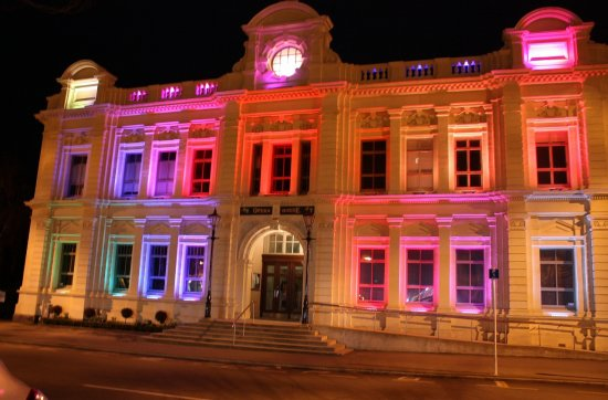 Oamaru opera house lights up at night like a musical christmas tree with rotating colours