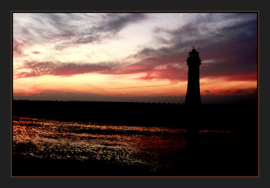 lighthouse architecture landscape seascape sunset silhouette sky clouds dramatic