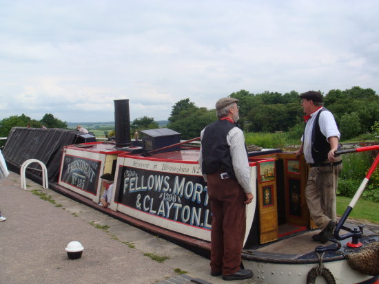 Historic narrowboats butty river canal men chatting