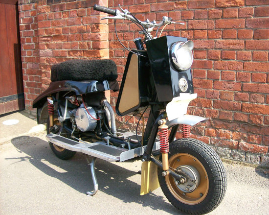 Flash: No (Turned off). Very early and pug ugly British scooter.