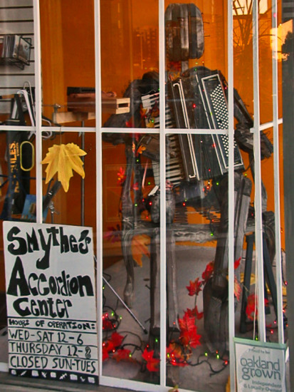 shop window shopfph sign signfph accordion sculpture autumn reflections