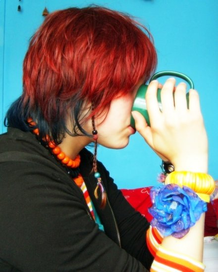 girl one drinking tea colours red hair blue