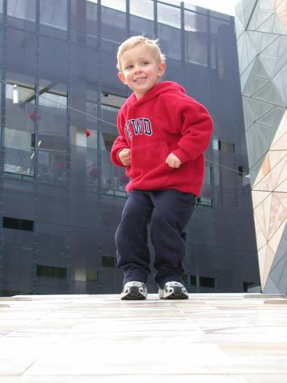 Dancing in Federation Square, Melbourne. [Taken by his mother.]