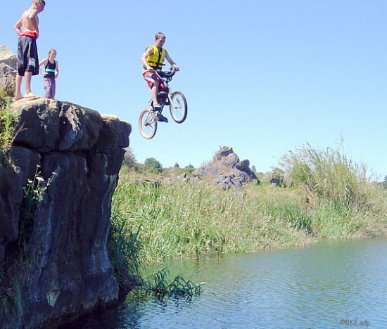 bike jump boy lake lakejumping