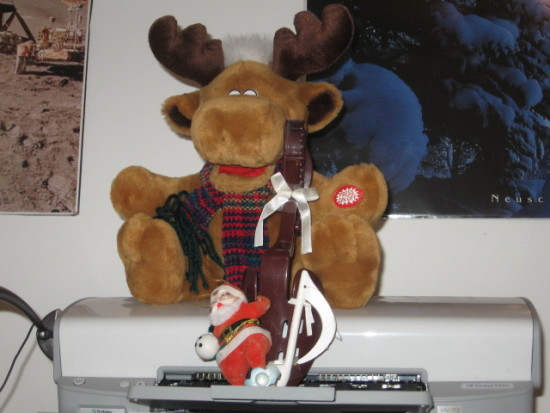 My reindeer sings the song about Grandma being run over by a reindeer and my (shoe) tree is up.