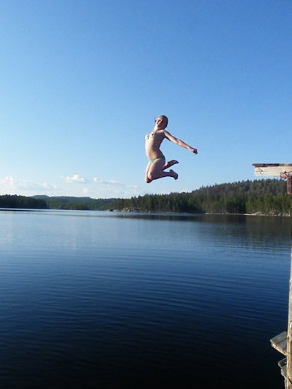 girl jump water fly