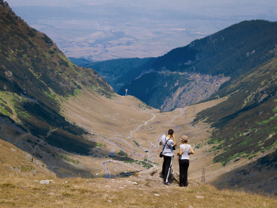 Transfagarasean, the other high altitude road of Romania. The little bugs on the valey are cars.....