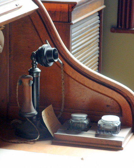 4/6 Preserved office at the Jackfield Tile Museum  Telephone, ink wells, roll-top desk.