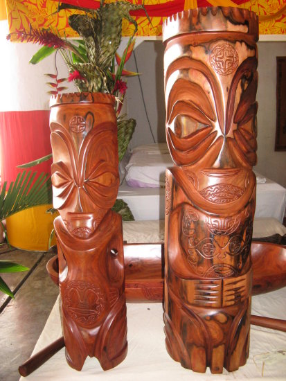 Two  tiki sculpted in the wood in the Marquises Islands. The piece on the right is sold 200 000 P...
