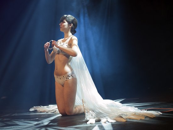 burlesque dancer bathed in light,cheers martyn
