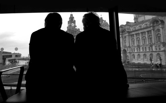 people candid window silhouette cityscape