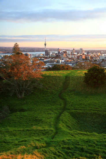 Auckland City at sunrise from the dormant volcanic cone Mt Eden, at least this one won't erupt an...