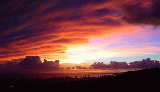Here's a dramatic sunset captured from my home. The clouds seemed to be carved into orange and pu...