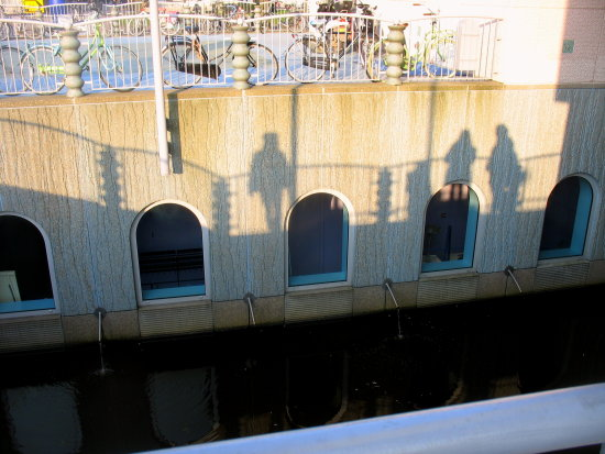 sunset shadows wall museum groningen bridge people