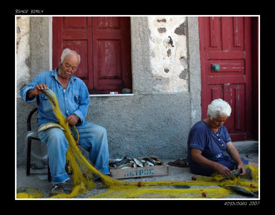 fish nets people family lesvos greece fisherman