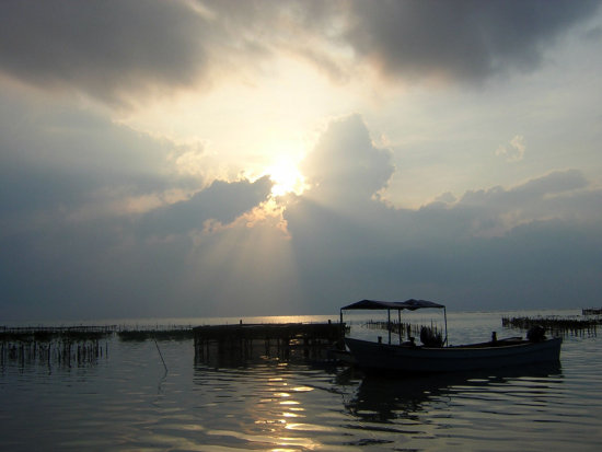 Welcoming the new day in between the salty water.   Morning at Pramuka Island.