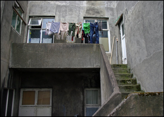grey building house clothes washing drying backside concrete texture