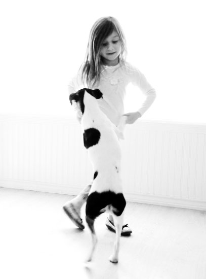 little girl dance puppy dog black and white