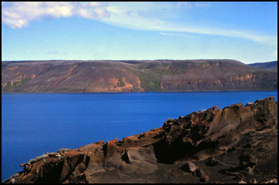 lake iceland formations blue jagged nature volcanic rock barren desolate