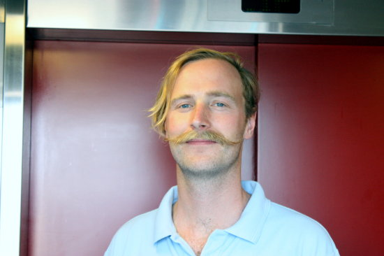 man blond moustache lift tower