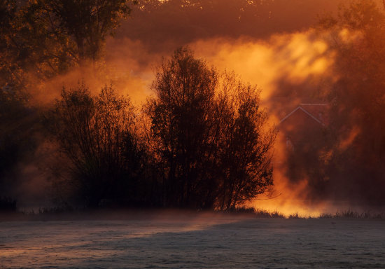 early morning fog with beautiful sunrise beaming causing the apprearance fire