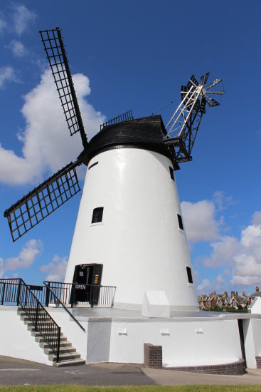 wind sky mill blue clouds flower corn bred windmill sails stone grind