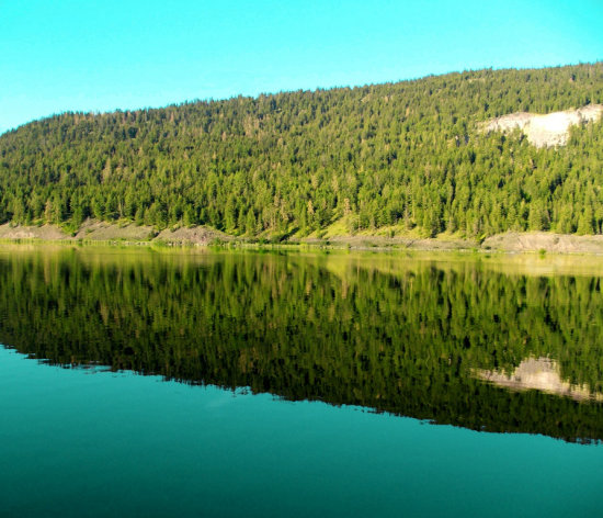 mountain water reflection green blue yellow sky lake
