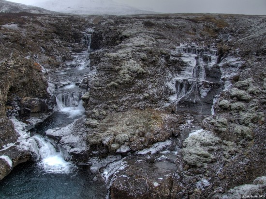 Frost foggy landscape waterfall botnsdalur iceland