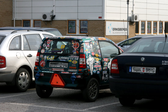 small car cowered with stickers