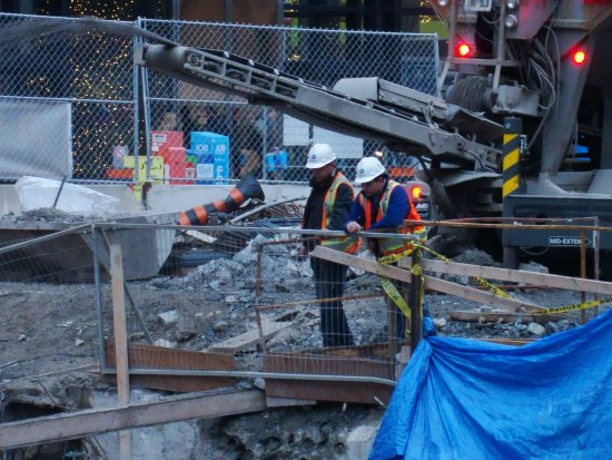 At 4:05pm.2nd Photo-Workers-On Front St.,Toronto,Ont.,On Monday,Dec.3,2012