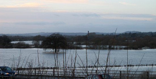 Worcester in the floods 1st January 2013   The tall chimney in the background is Powick Mill.