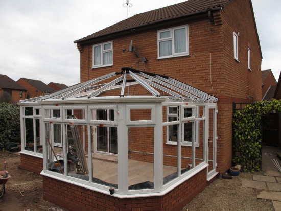 10. ...patio doors into the house and the completion of the frame including the roof.