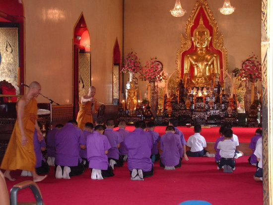 Young boys in training at the Wat Traimit Temple Bangkok Thailand