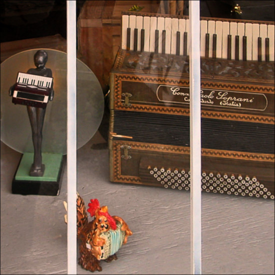 accordion figurine music shop shopfph window chicken
