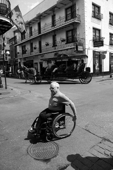 New Orleans French Quarter carriage wheel chair bw candid