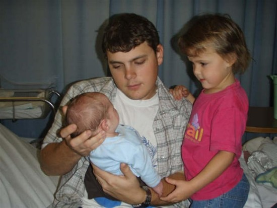 This is a photo of my best friends husband holding his new born son and this is his daughter look...
