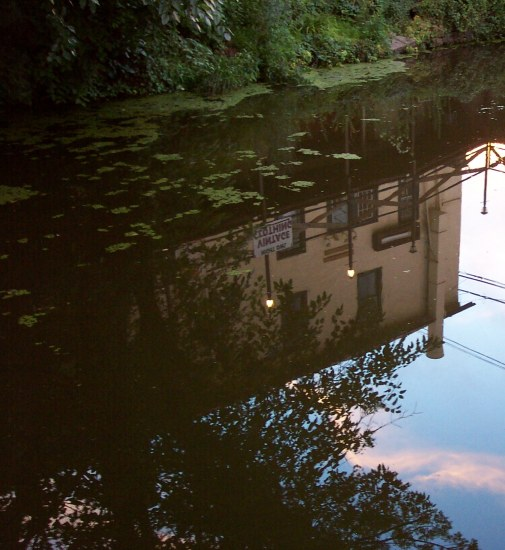 water reflections canal sunset