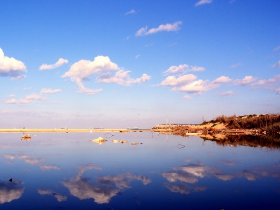 water reflection sea beach sky blue clouds nature