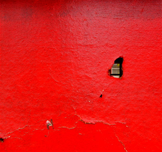 boarded window hole red alley