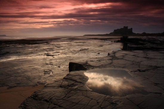 sunrise beach Bamburgh castle Northumberland